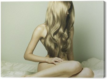 Obraz na Płótnie Zmysłowa dziewczyna w łóżku