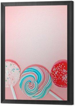Obraz w Ramie Różowe tło z kolorowymi Cukierki