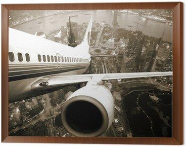 Obraz w Ramie Samolot startu z miasta nocą.