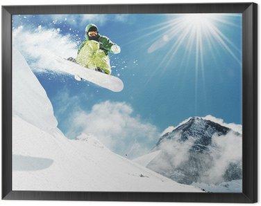 Obraz w Ramie Snowboarder w górach skok inhigh