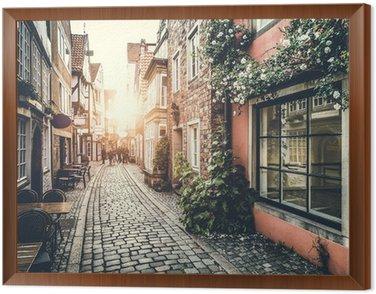 Obraz w Ramie Zabytkowej ulicy w Europie na zachód słońca z efektu retro vintage