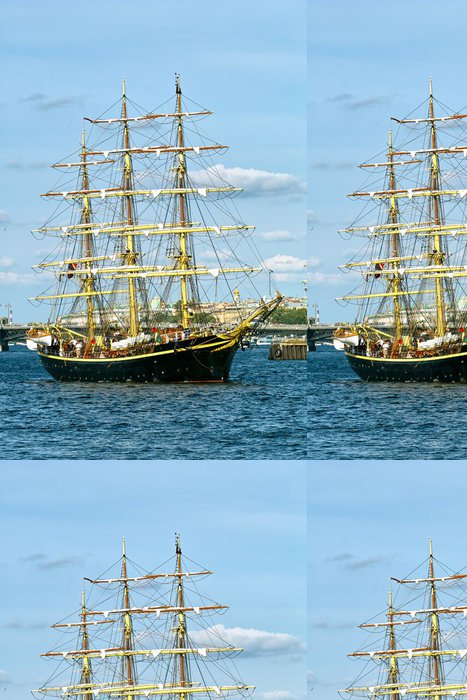 Papel de Parede em Vinil Black sailboat with yellow masts at the background of blue sky - Barcos