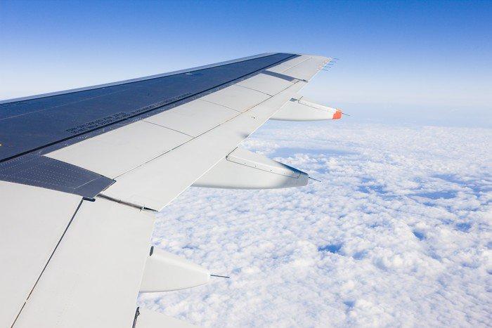 Papier Peint à Motifs Vinyle Transport aérien - aile de plan - Dans les airs