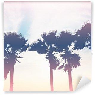Papier Peint Vinyle Arbres silhouette de palmiers au coucher du soleil