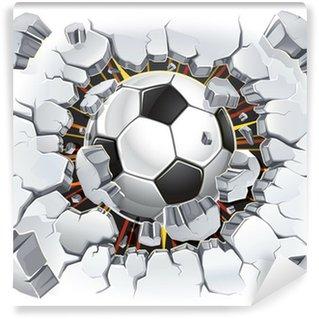 Papier Peint Vinyle Ballon de football passant à travers un mur