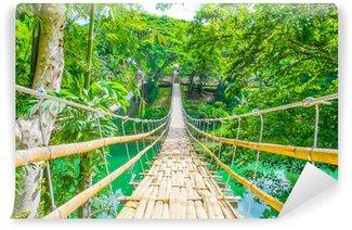 Papier Peint Vinyle Bamboo pont suspendu pour piétons sur la rivière