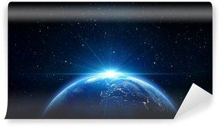 Papier Peint Vinyle Bleu lever du soleil, vue de la Terre depuis l'espace