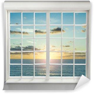 Papier Peint Vinyle Fenêtre résidentielle moderne avec vue sur la mer au coucher du soleil