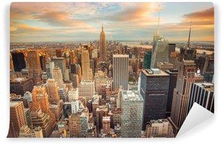 Papier Peint Lavable Coucher de soleil sur New York donnant sur le centre de Manhattan