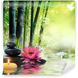 Papier Peint Vinyle Massage dans la nature - lis, pierres, bambou - notion zen
