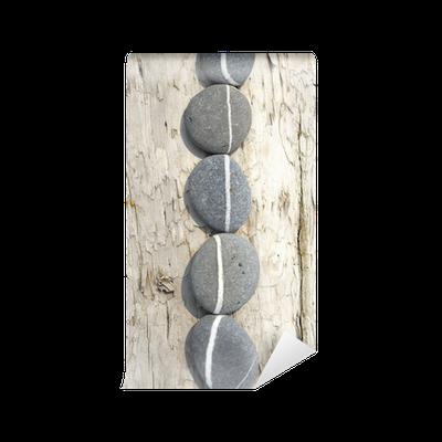 papier peint rang e de pierres plates sur bois flott pixers nous vivons pour changer. Black Bedroom Furniture Sets. Home Design Ideas