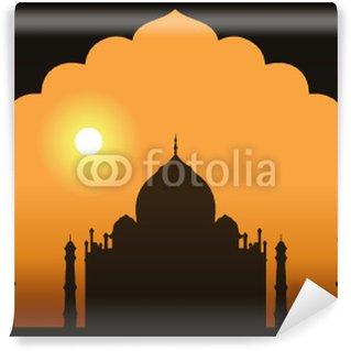 Papier Peint Vinyle Une vue du Taj Mahal encadrée par une porte.
