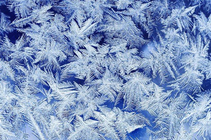 Fototapeta Vinylowa Piękna świąteczna mroźny wzór z Białe płatki śniegu na niebieskim tle na szkle - Zasoby graficzne