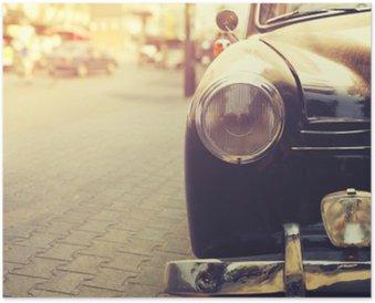 Plakát Detail světlometů klasické auto zaparkované v městském - výběrový efekt filtru stylu