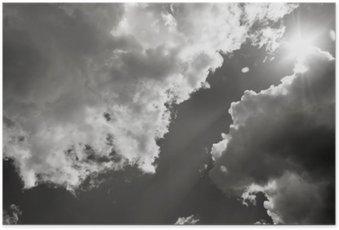 Plakát Slunce proráží mraky. Černobílá fotografie