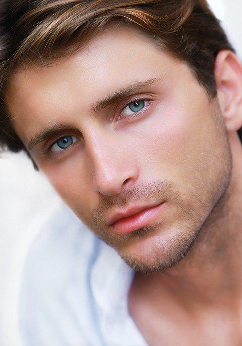 Obraz na Płótnie Portret handsoome mężczyzną o niebieskich oczach - Mężczyźni