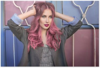 Beautiful hipster fashion model with curly pink hair posing in front of the colorful wall Poster