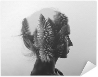 Creative double exposure with portrait of young girl and flowers, monochrome