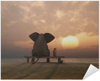 elephant and dog sit on a summer beach