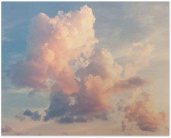 Poster Roze wolken tegen een blauwe lucht