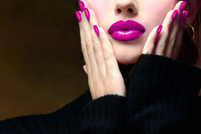 Pretty woman with a pink makeup