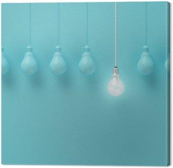 Quadro su Tela Hanging lampadine con incandescente un'idea diversa su sfondo azzurro, concetto idea minimale, distesi, top