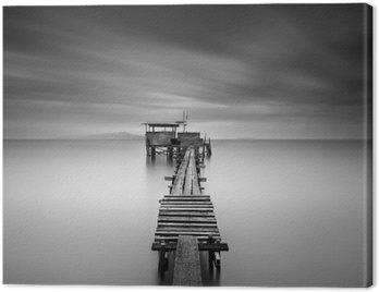 Quadro su Tela Immagine Arte del molo di pesca in legno alla spiaggia in esposizione bianco e white.Long girato con la sfuocatura di movimento.
