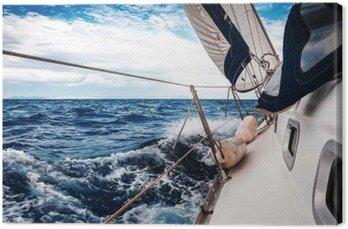 Quadro su Tela Le vele bianche di yacht sullo sfondo del mare e del cielo tra le nuvole