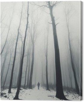 Quadro su Tela Uomo nella foresta con alberi ad alto fusto in inverno