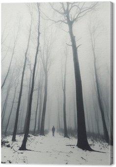Quadro em Tela Homem na floresta com árvores altas no inverno