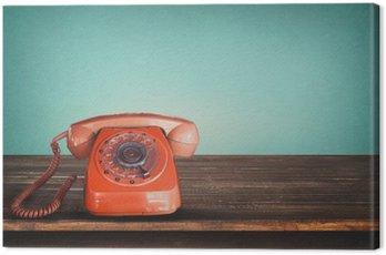 Quadro em Tela Telefone vermelho retro velho na tabela com fundo pastel verde do vintage