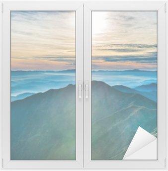 Raamsticker Zonsondergang in de bergen