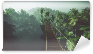 Samolepicí Fototapeta Rope bridge in misty jungle with palms. Backlit.