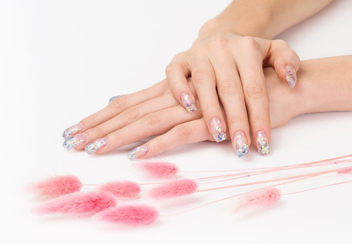 Sparkle gel nails and pink decoration spikes