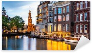 Sticker Pixerstick Amsterdam paysage urbain avec la Tour de la Monnaie au crépuscule