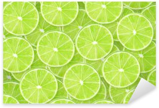 Background of lime sliced pieces Sticker - Pixerstick