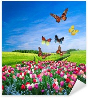 Sticker Pixerstick Champ de fleurs colorées et d'un groupe de papillon
