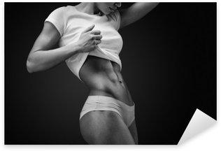 Sticker - Pixerstick Close-up of muscular abdomen of female model