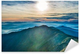 Sticker Pixerstick Coucher de soleil dans les montagnes