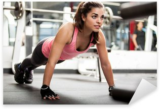 Cute brunette working out at a gym Sticker - Pixerstick