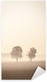 Sticker Pixerstick Deux arbres Lonley dans la brume