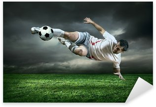 Football player with ball in action under rain outdoors Sticker - Pixerstick
