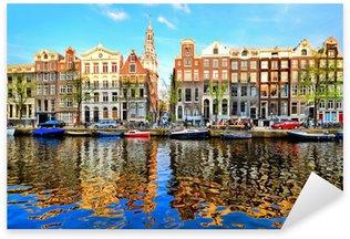 Pixerstick Sticker Grachtenpanden van Amsterdam in de schemering met levendige reflecties
