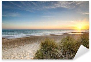 Sticker Pixerstick Lever de soleil sur une plage déserte