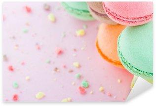 Macaroons on pastel pink background