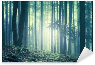 Pixerstick Sticker Magische blauwgroene verzadigd mistig bos bomen landschap. Kleurfilter effect gebruikt. Het beeld werd genomen in het zuidoosten van Slovenië, Europa.