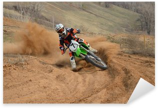 Motocross rider with a strong slope turns sharply Sticker - Pixerstick