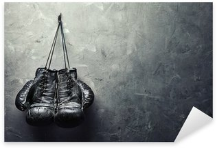 old boxing gloves hang on nail on texture wall Pixerstick Sticker