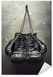 old boxing gloves hang on nail Sticker - Pixerstick