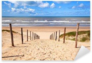 Pixerstick Sticker Pad naar zandstrand door Noordzee